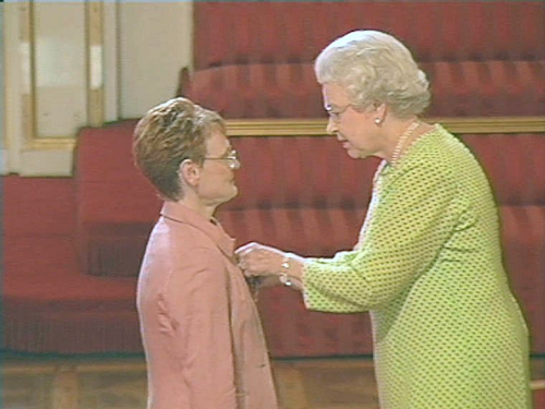 Sarah being awarded her OBE in 2004